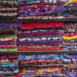 Stock Photo: Colurful scarfs on shelves