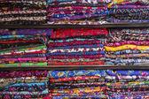 Colurful scarfs on shelves — Zdjęcie stockowe