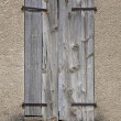 Closed wooden shutters on window — Stock Photo