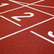 Athletics Start track lanes - Stock Photo