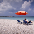Sun longer and umbrella on empty sandy beach — Stock Photo #30607787