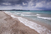 Rock beach with big wave — Stock Photo