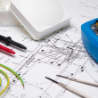 Electrical instruments laying on blueprint - Stockfoto