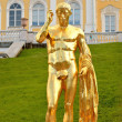 Golden statue at Petrodvorets palace — Stock Photo
