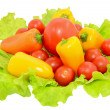 Stock Photo: Peppers and tomatoes on lettuce leaves