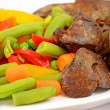 Boiled vegetables with chicken liver - Stock Photo