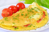 Omelet with herbs and vegetables on the plate — Stock Photo