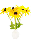 Yellow rudbeckia flowers in ceramic vase — Stock Photo