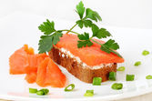 Sandwich with salmon and parsley — Stock Photo