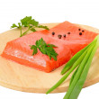 Salmon fillet, green onion and parsley on kitchen board — Stock Photo