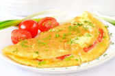 Omelet with herbs and vegetables — Stock Photo