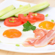 Breakfast with bacon, fried eggs and slices tomatoes — Stock Photo #25955413
