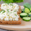 Sandwiches with curd cheese and cucumber slices — Stock Photo #30636639