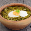 Sorrel soup with egg and sour cream — Stock Photo