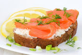 Sandwich with salmon and lemon slices — Stock Photo
