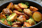 Roasted potato in a frying pan — Stock Photo