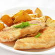 Fried fish fillet with baked potatoes — Stock Photo