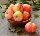 Red ripe apples on wooden table — Stock Photo