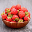 Stock Photo: Strawberries on wooden table
