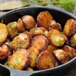 Stock Photo: Roasted potato in frying pan