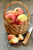 Apples in the wicker basket — Stock Photo