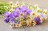 Bouquet of wild flowers on wooden table — Stock Photo