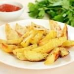 Fried potato wedges — Stock Photo