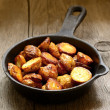Roasted potato in a frying pan — Stock Photo #40205471