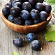 Stock Photo: Plums in wooden bowl