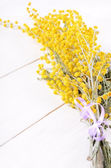 Mimosa flowers on wooden table — Foto de Stock