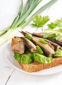Sprats sandwich — Stock Photo