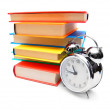 Multi-coloured books and alarm clock. — Stock Photo