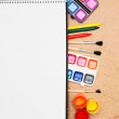 Notebook, school accessories on rumpled paper. - Stock Photo