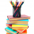 Multi-coloured books and basket with pencils. — Stock Photo #12884869
