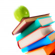 Royalty-Free Stock Photo: Books and a green apple. On white background.