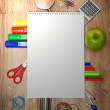 Stock Photo: School accessories on a wooden background.