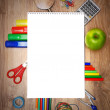 School accessories on a wooden background. — Stock Photo #12885210