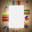 Stock Photo: School accessories on wooden background.