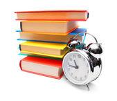 Multi-coloured books and alarm clock. — Stock Photo