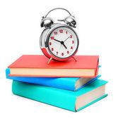 The alarm clock and books . — Stock Photo