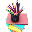 Multi-coloured books ,basket with pencils. — Stock Photo #12896071