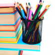 图库照片: Multi - coloured books and basket with pencils.
