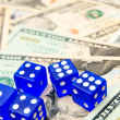 Dark blue dices and dollars. — Stock Photo