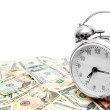 Alarm clock on banknotes (dollars). — Stock Photo
