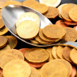 Stock Photo: Spoon. scattering of coins.