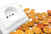 The socket electric and gold coins. — Stock Photo