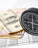Compass and money (dollars) on documents. — Stock Photo
