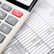 The calculator on documents. Accounts department. — Stock Photo