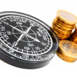 Royalty-Free Stock Photo: Compasses and columns of gold coins.