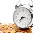 Stock Photo: Alarm clock on gold coins.
